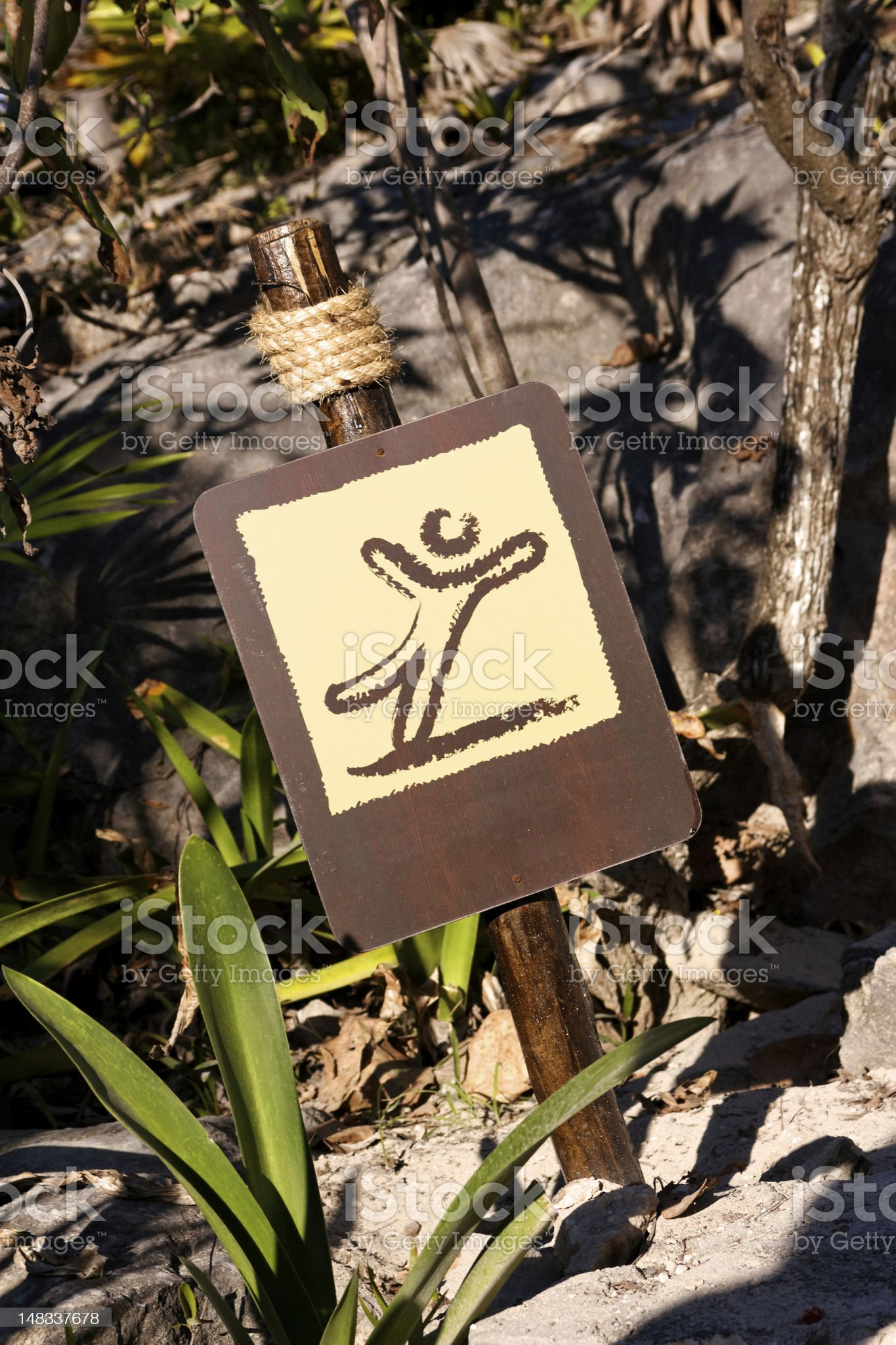 Brown Sign with Pictogram of Falling Man royalty-free stock photo