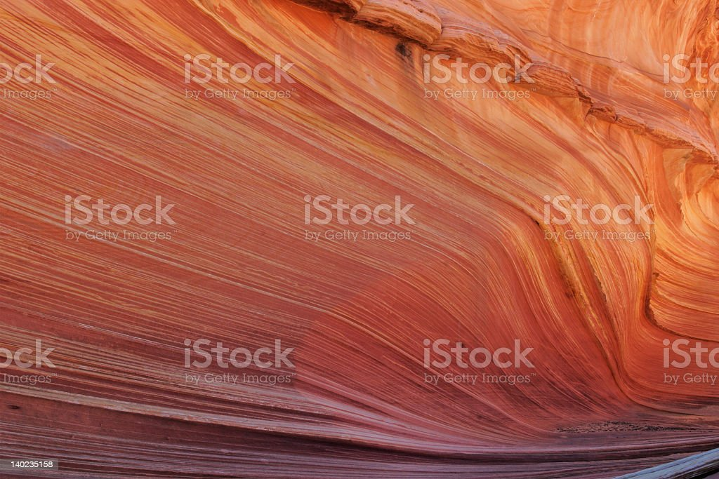 A brown slick rock formation background royalty-free stock photo