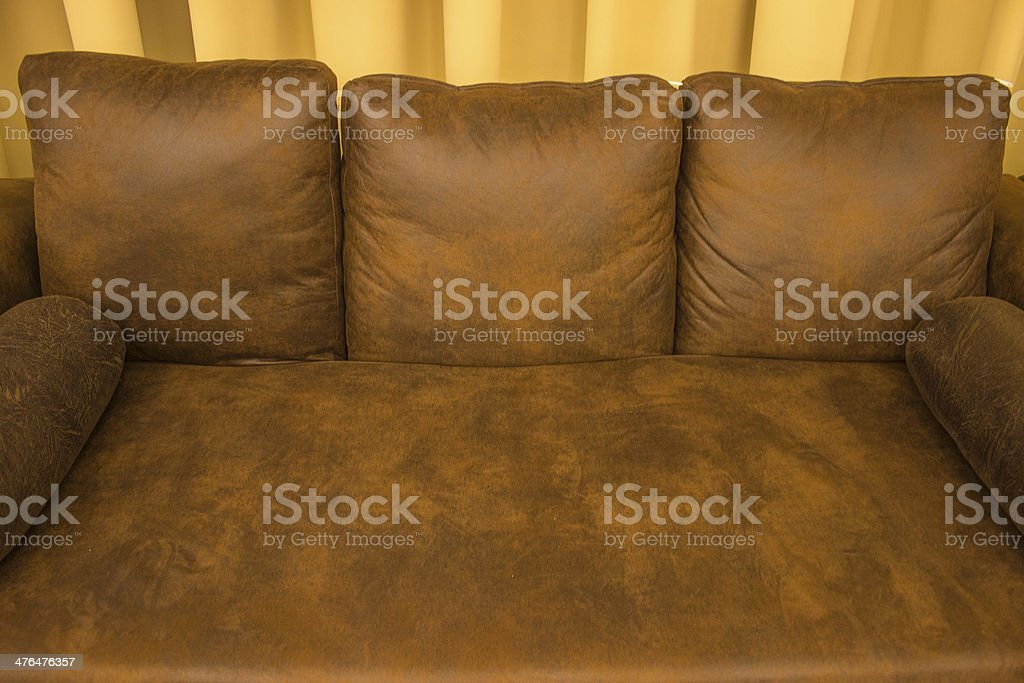 Brown sofa and pillows. royalty-free stock photo