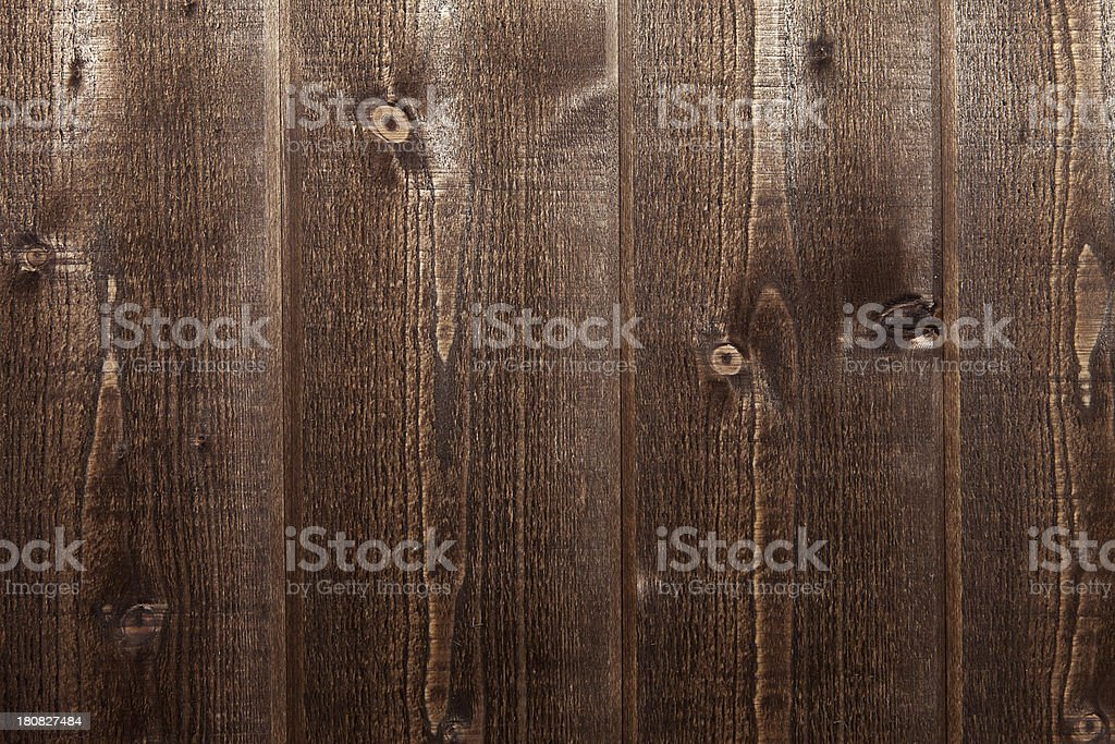 Brown stained planks of wooden wall stock photo