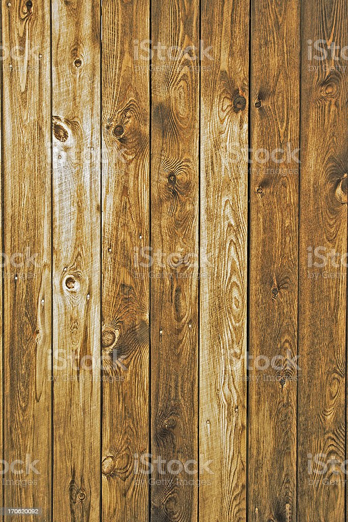 Brown stained planks of wooden wall texture background stock photo