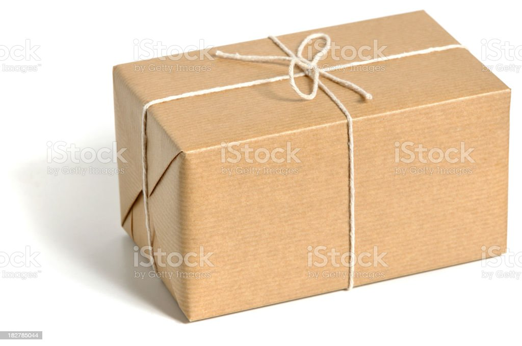 Brown standard size wrapped parcel with thin ropes stock photo