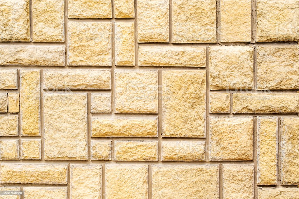 brown stone wall with grey concrete lines stock photo