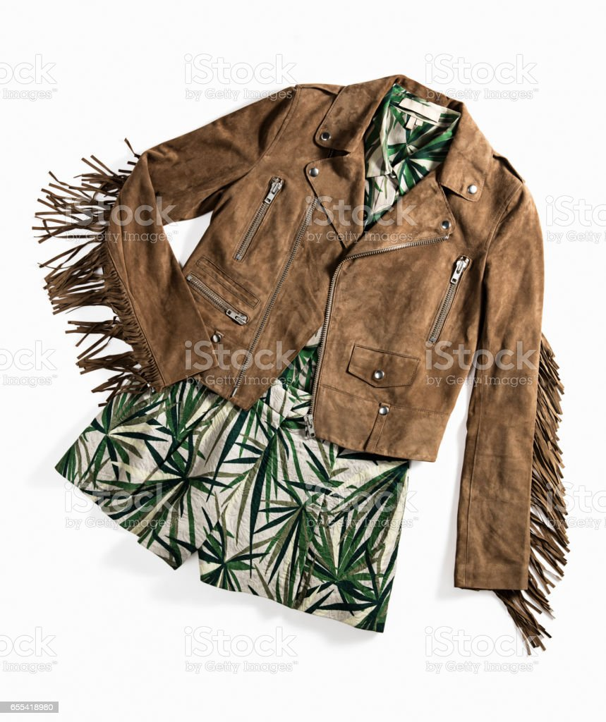 Brown suede jacket and green dress stock photo