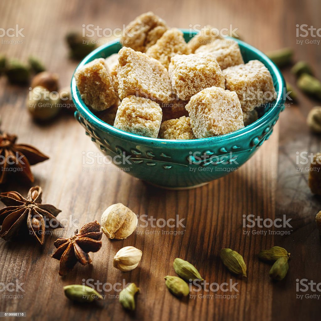 Brown sugar and spices cardamom and anise stock photo