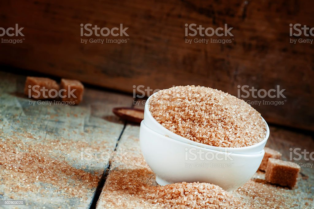 Brown sugar in a white porcelain bowl stock photo