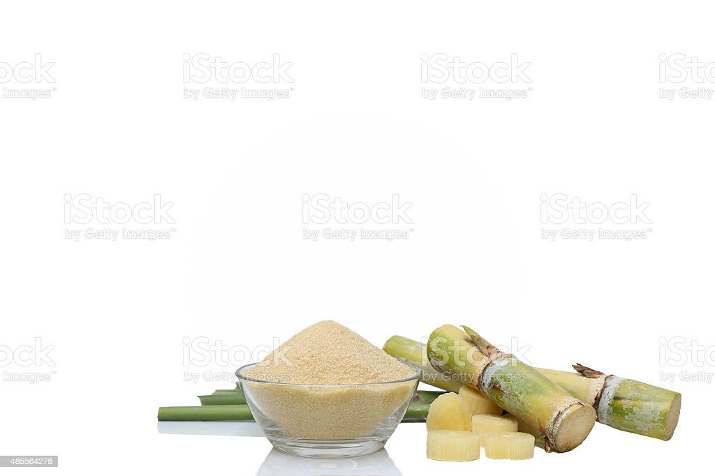 Brown Sugar in bowl and stump of sugar cane stock photo