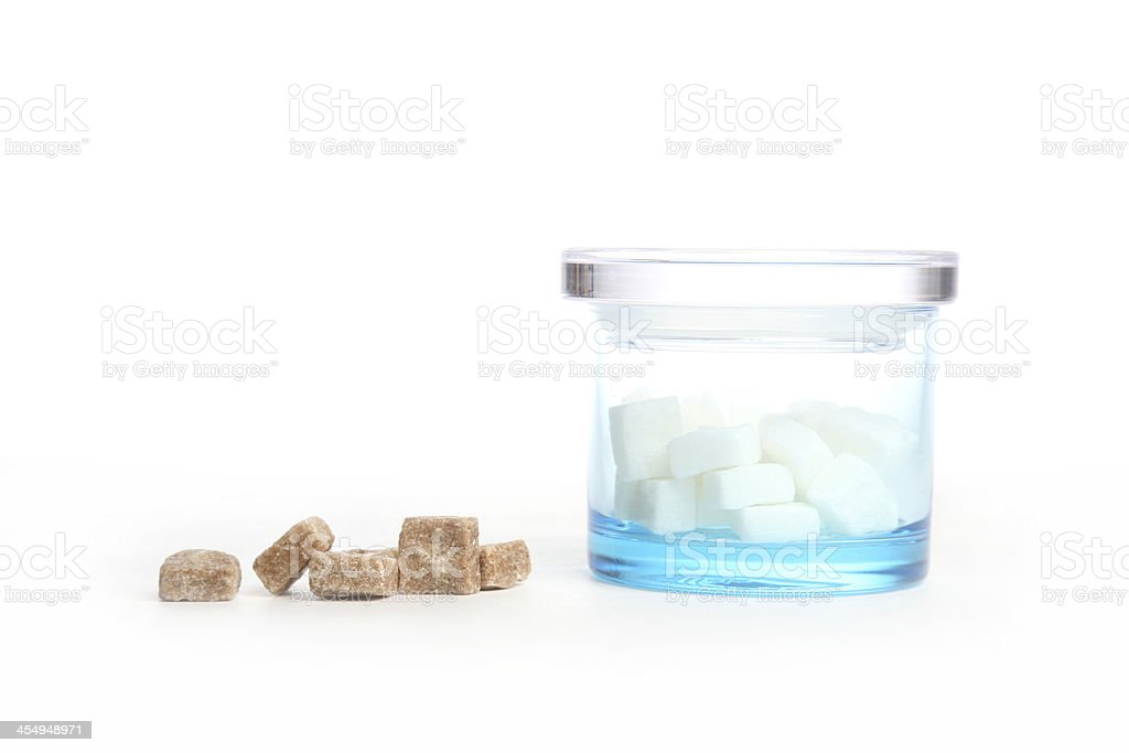 Brown sugar next to jar of white one royalty-free stock photo