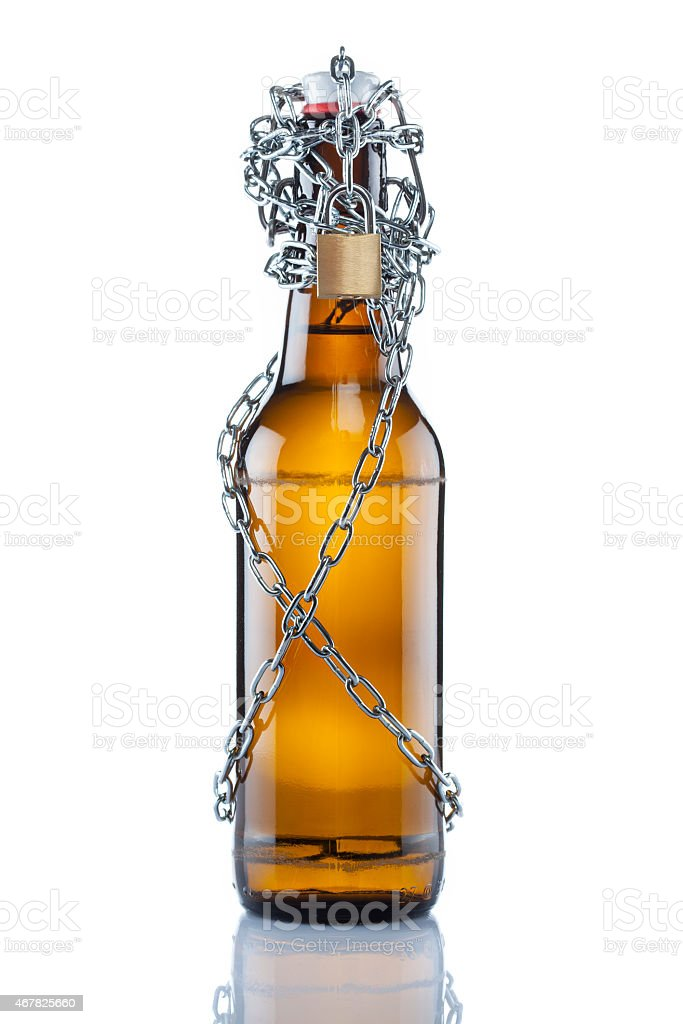 Brown swing top beer bottle in chains stock photo