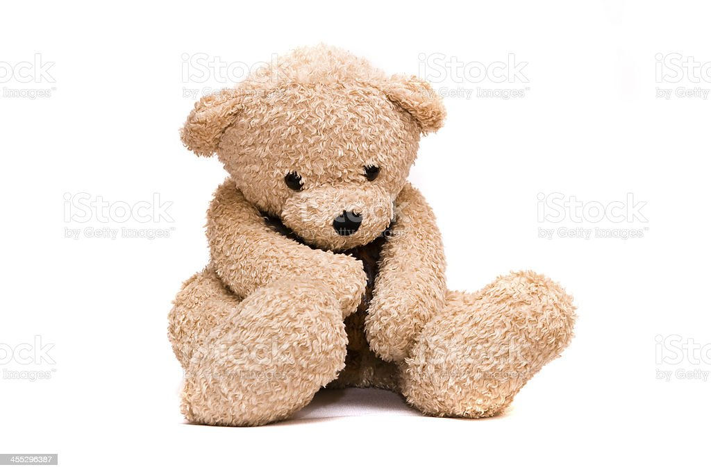 Brown teddy bear looking sad and alone stock photo