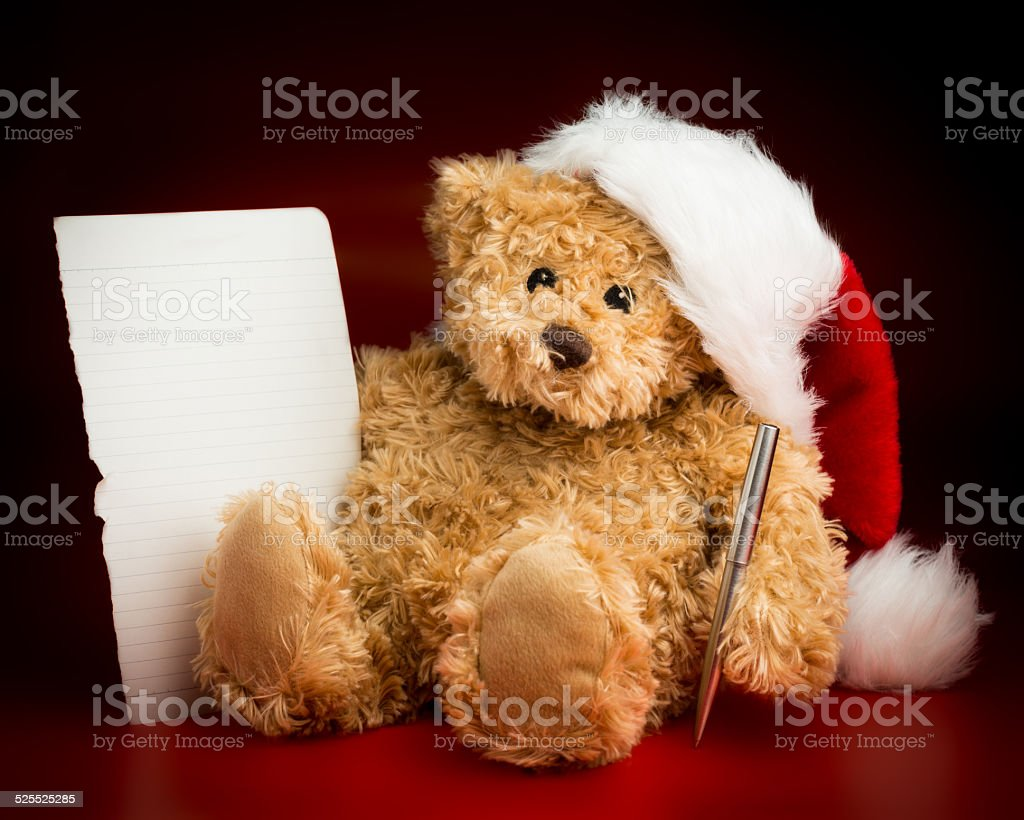 Brown Teddy Bear Writing a Letter to Santa Claus stock photo