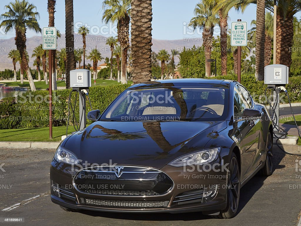 Brown Tesla Model S at Level 2 Charging Station royalty-free stock photo