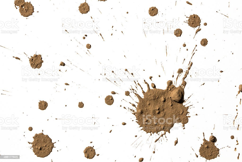 Brown textured clay randomly splattered on a white surface stock photo