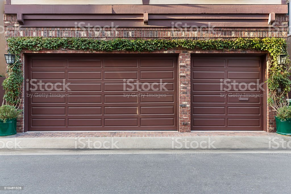 Brown three car garage stock photo