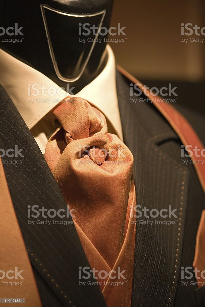 brown tie and black suit on shop mannequins royalty-free stock photo