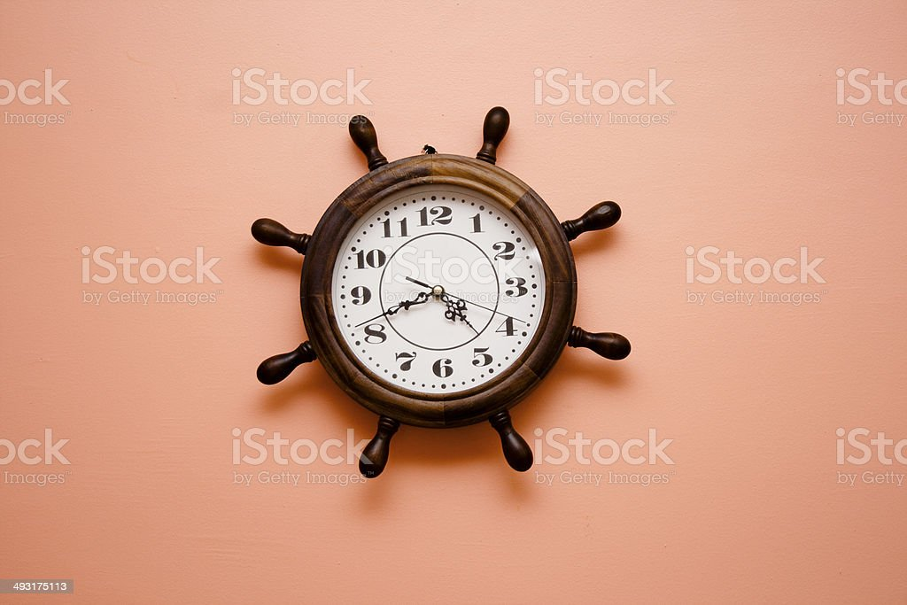 Brown Time Clock hanging on the Wall stock photo