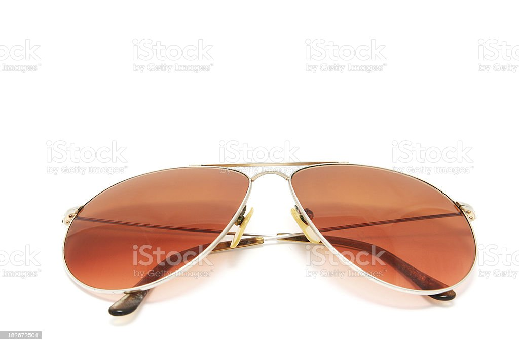 Brown tinted Metal Sunglasses on White Background royalty-free stock photo