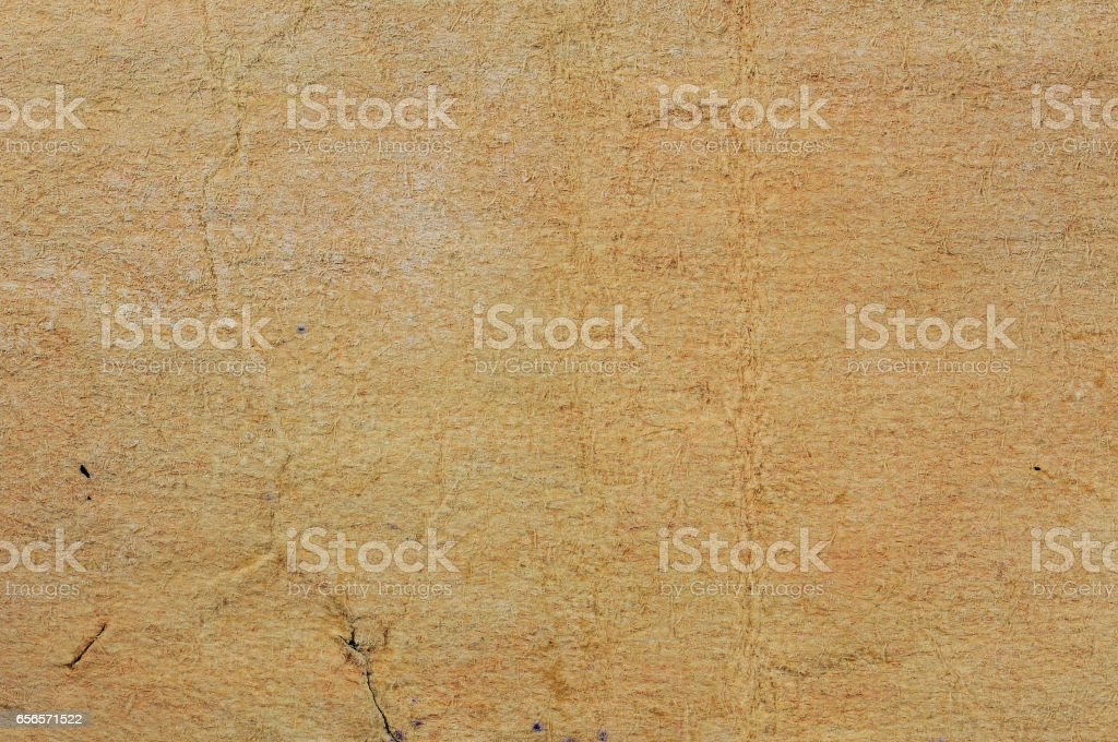 Brown torn damaged paper. For texture and graphic element. stock photo
