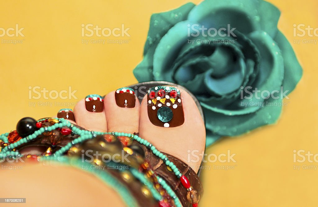 Brown turquoise design pedicure. royalty-free stock photo