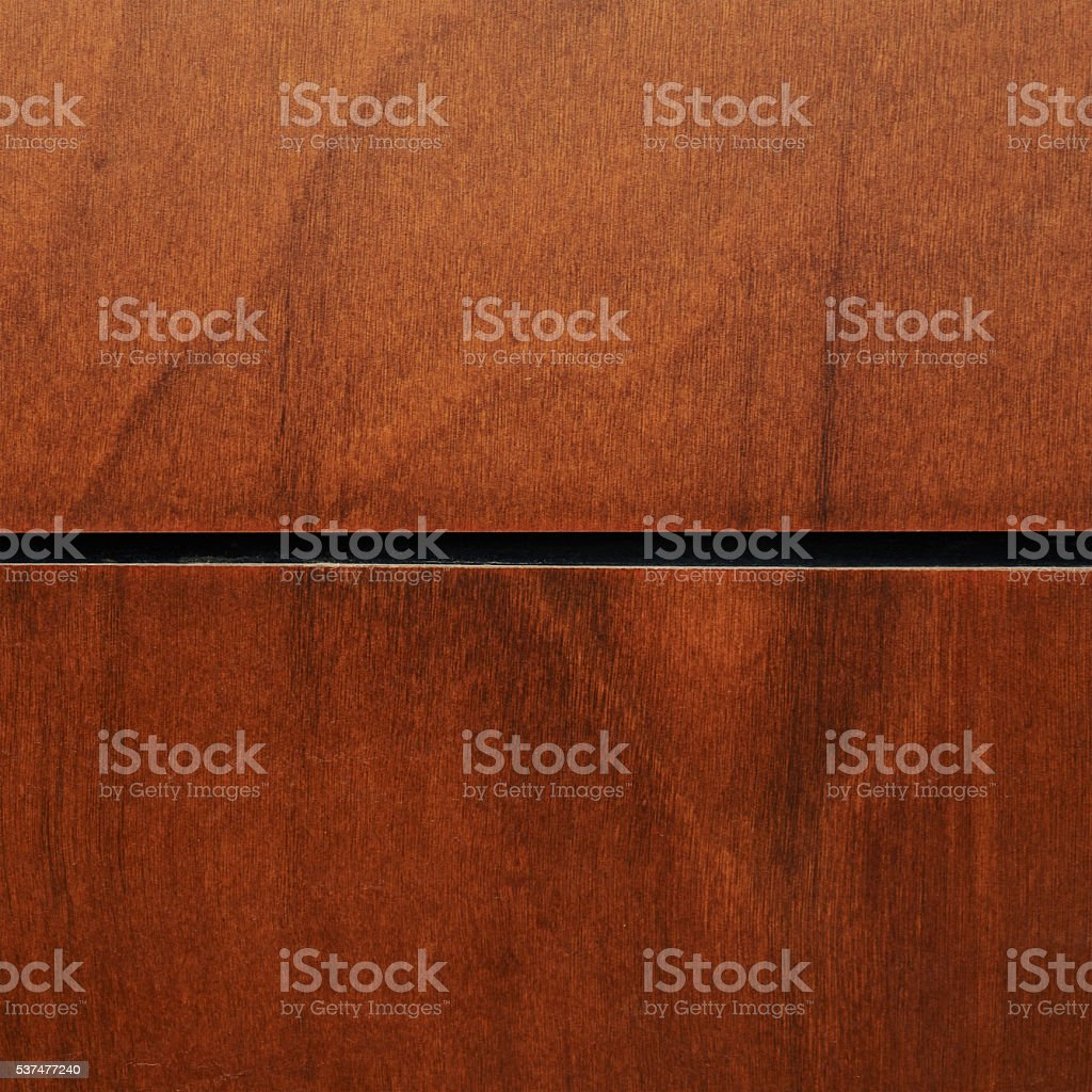 Brown varnished wood fragment stock photo