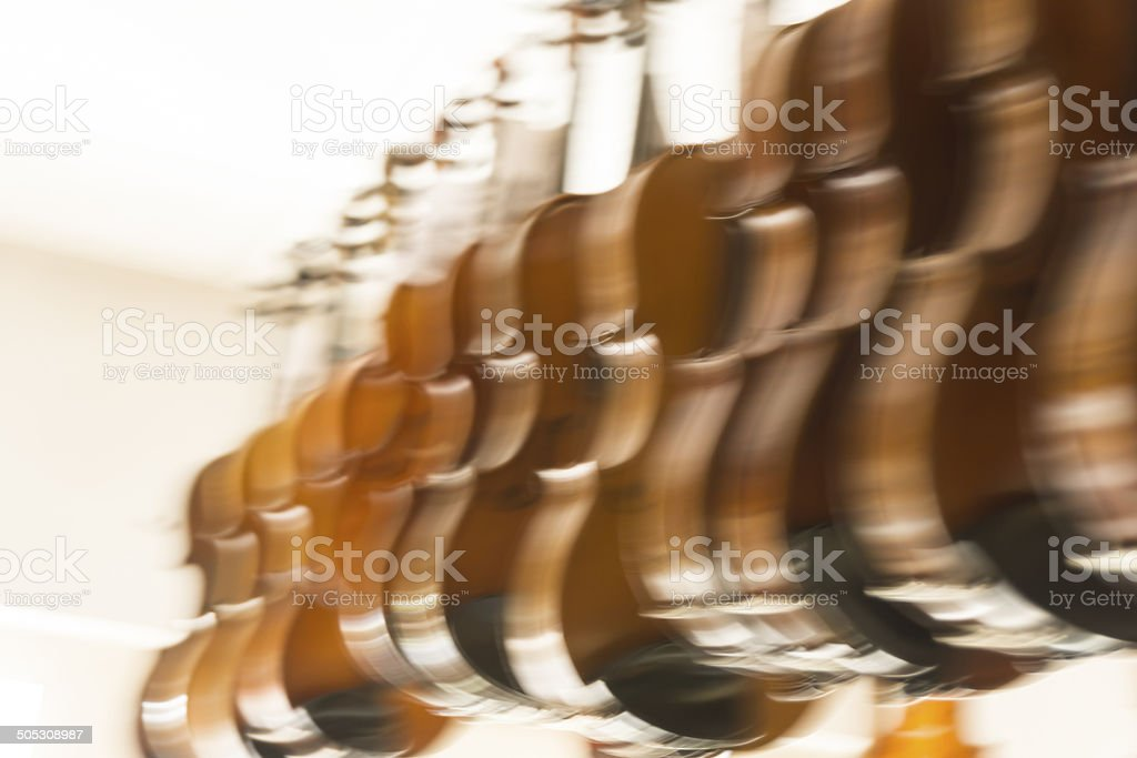 Brown violins hanging on the ceiling royalty-free stock photo