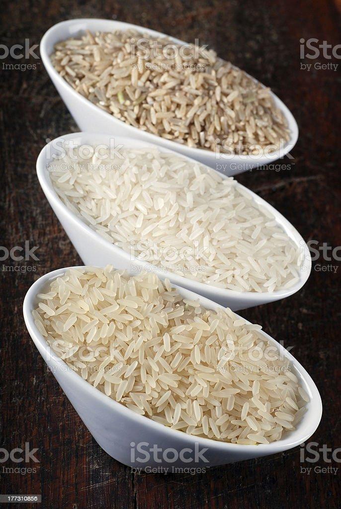 brown, wild and white (jasmine) rice royalty-free stock photo