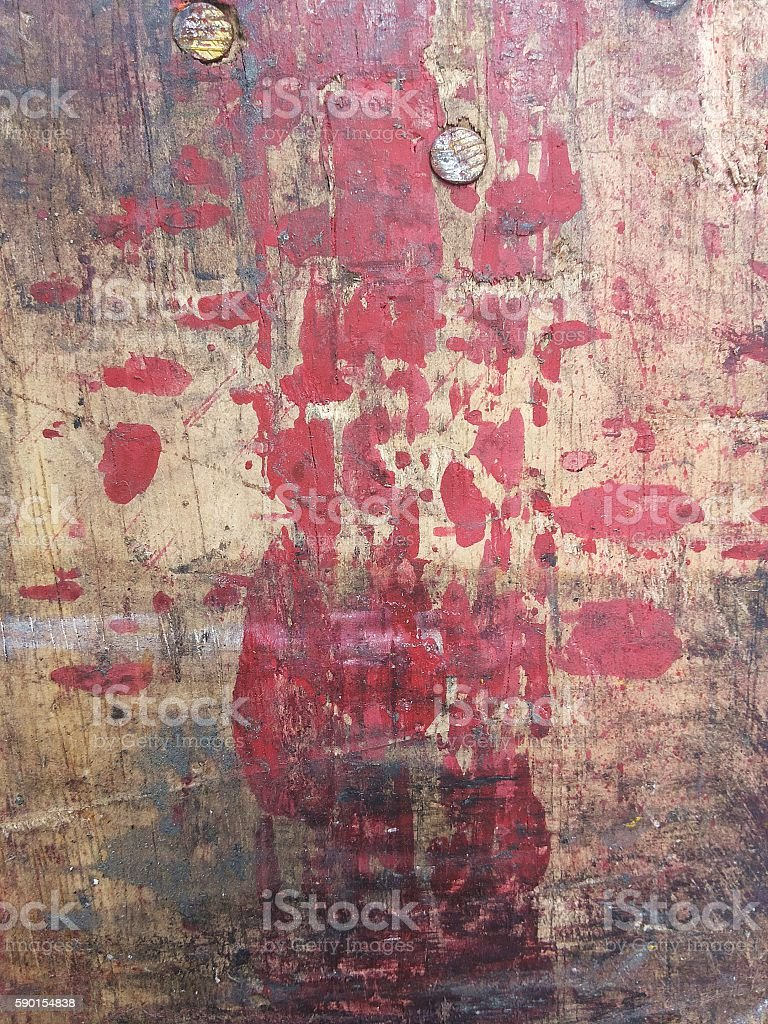 Brown wood sheet with black and red stains on surface stock photo