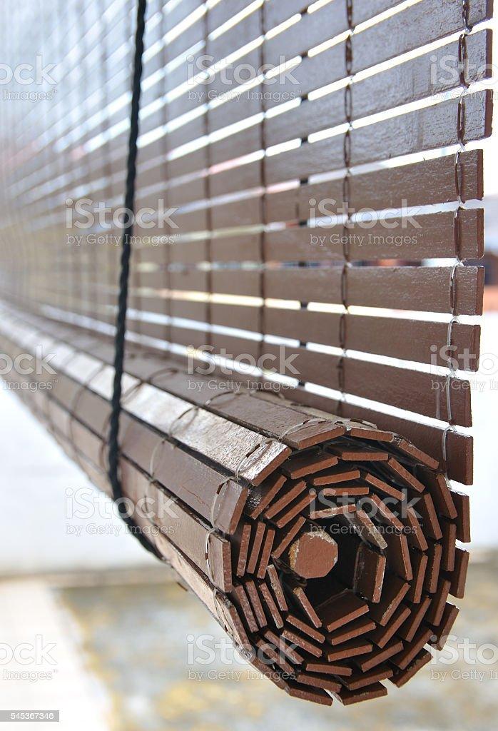 Brown wooden blinds hanging outside a residential home foto de stock libre de derechos