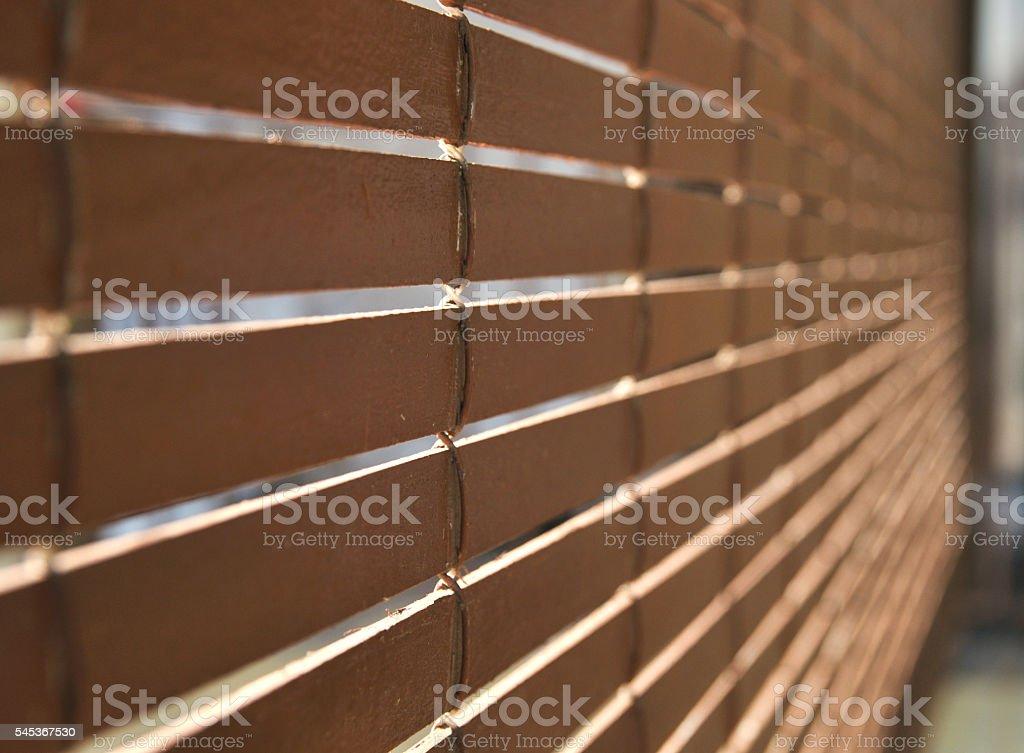 Brown wooden blinds rolled out foto de stock libre de derechos