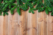 Brown wooden  boards and  green christmas tree branches