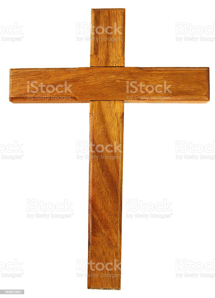 A brown wooden cross made up of two pieces of wood royalty-free stock photo