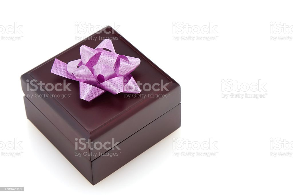 Brown Wooden Gift Box With Magenta Color Bow royalty-free stock photo