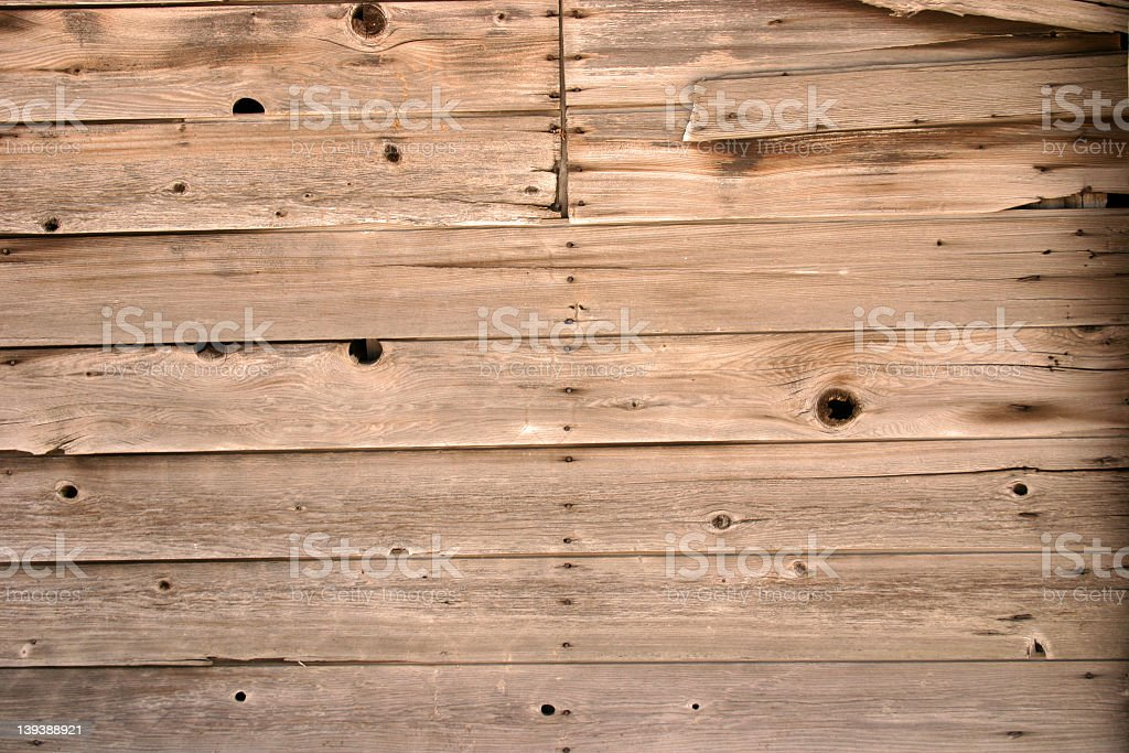 Brown wooden planks with black markings royalty-free stock photo