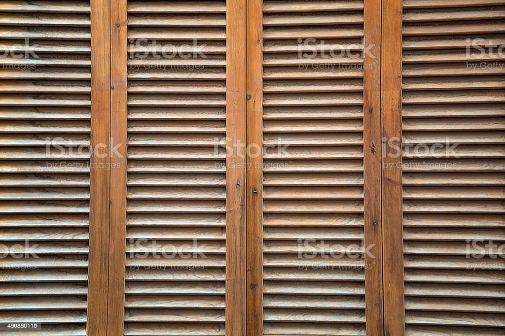 Brown, wooden, vertical completely covered blinds stock photo