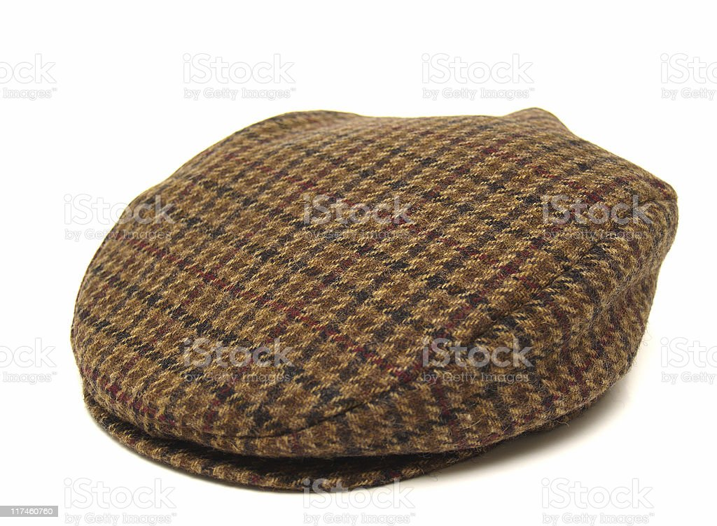 A brown wool cap with green and red design stock photo