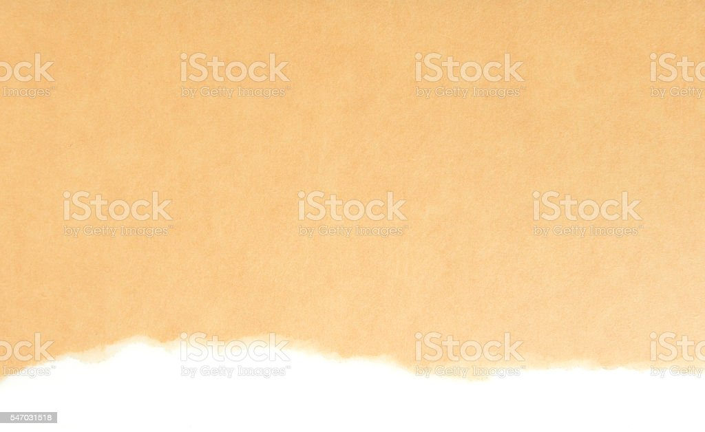 Brown wrapping paper torn to reveal white background foto de stock libre de derechos