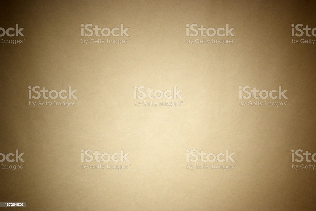 Brown wrapping paper with spotlight stock photo