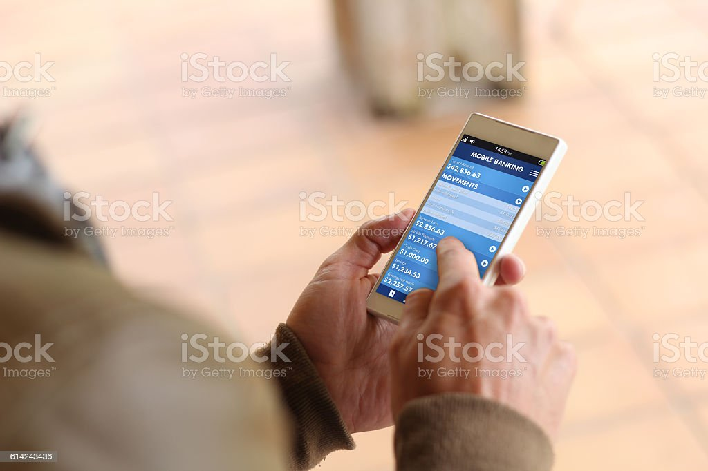 Brown young man smartphone mobile banking stock photo