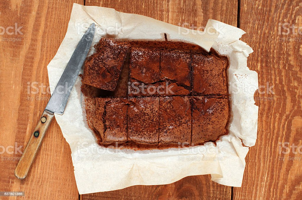 Brownie and knife on the wooden table stock photo