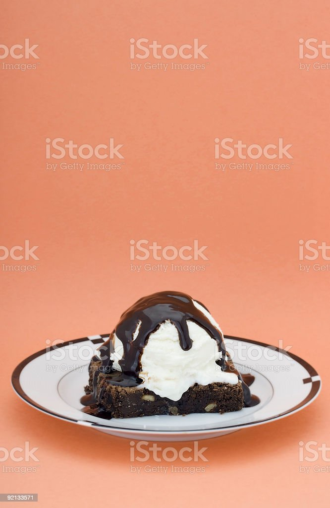 Brownie dessert on orange background stock photo