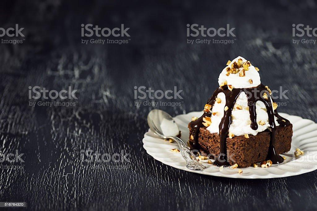 Brownie Sundae with Vanilla Ice Cream, Nuts, and Chocolate Sauce stock photo