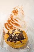 Brownie tart with sliced almond and vanilla ice cream