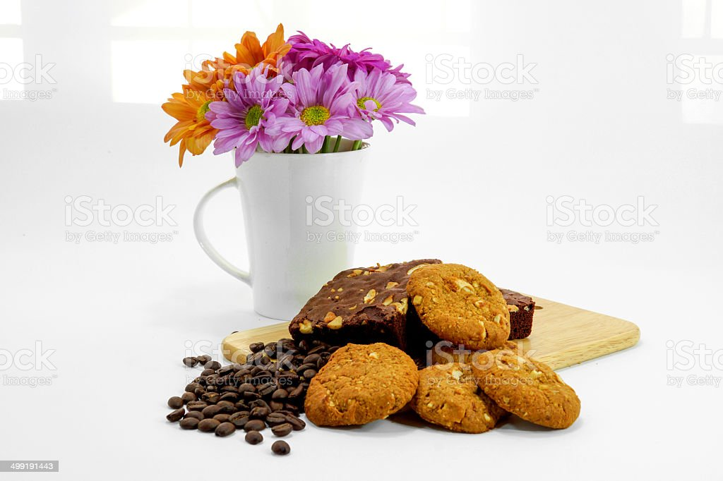 Brownies cookies with coffee beans and windows light background. royalty-free stock photo