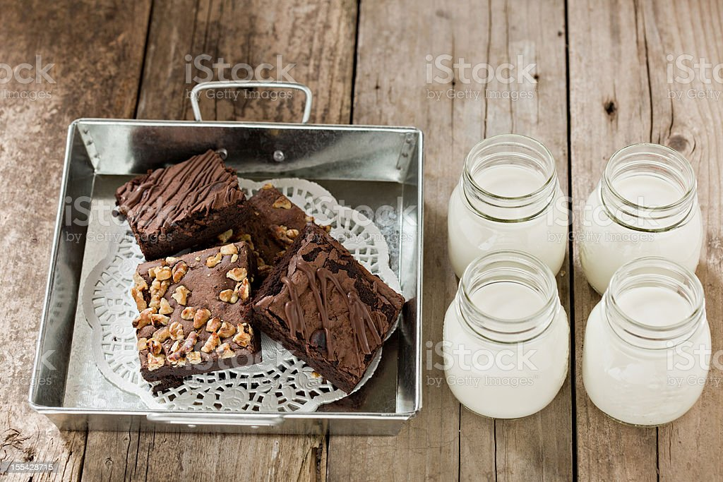 Brownies In A Tin Container And Glasses of Milk stock photo