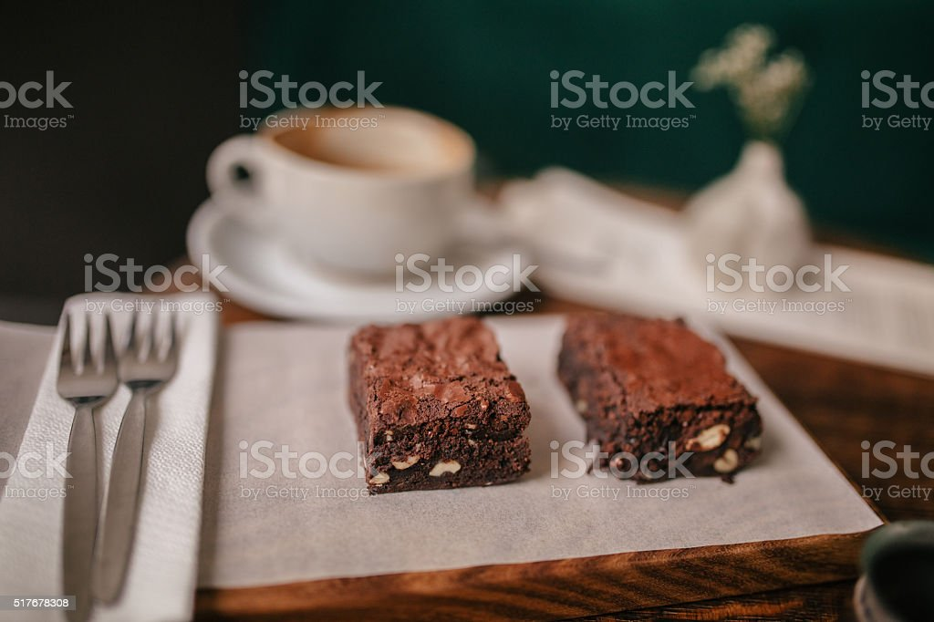 Brownies on wooden table with cup of Coffee in cafe stock photo