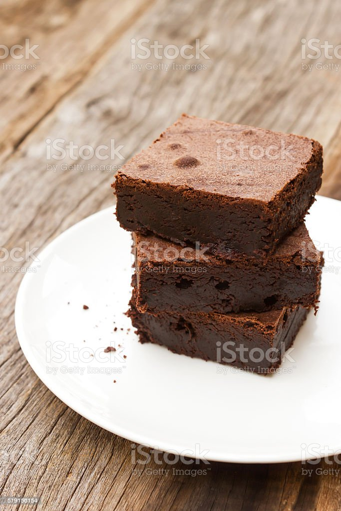 Brownies sliced on white plate. stock photo