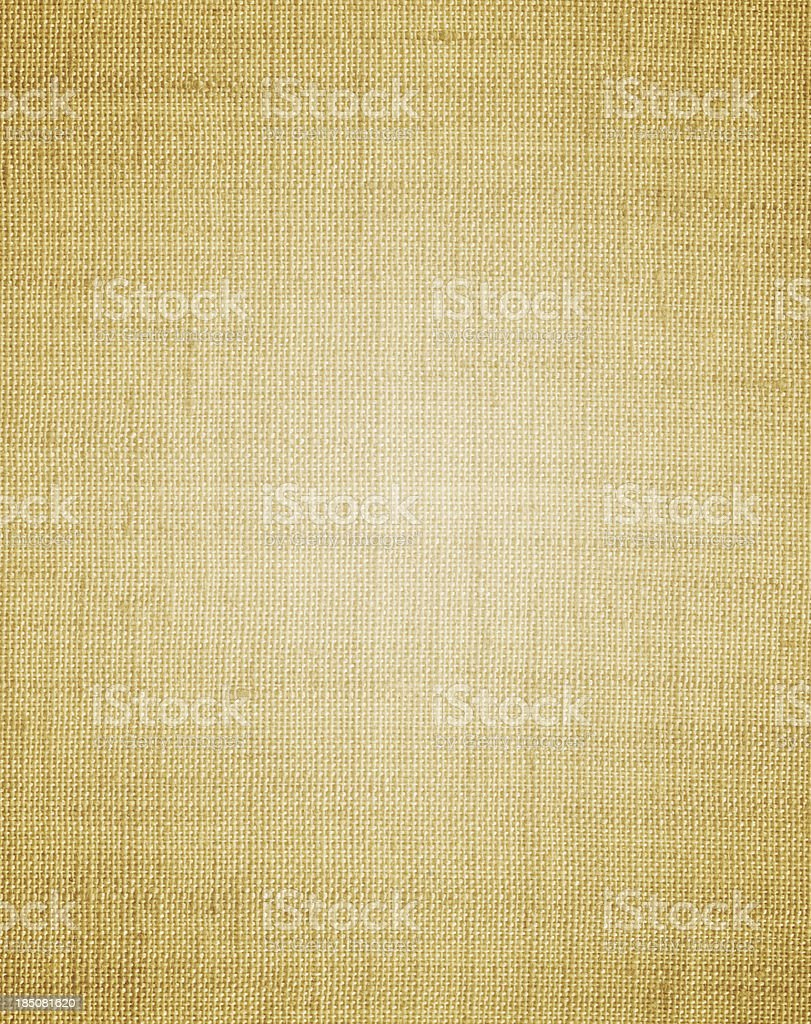 Brownish canvas background with light in the center royalty-free stock photo