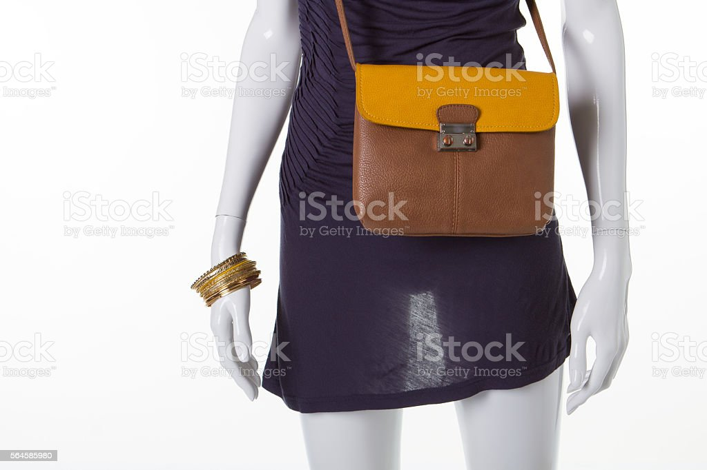 Brownish-yellow leather bag on a mannequin. stock photo