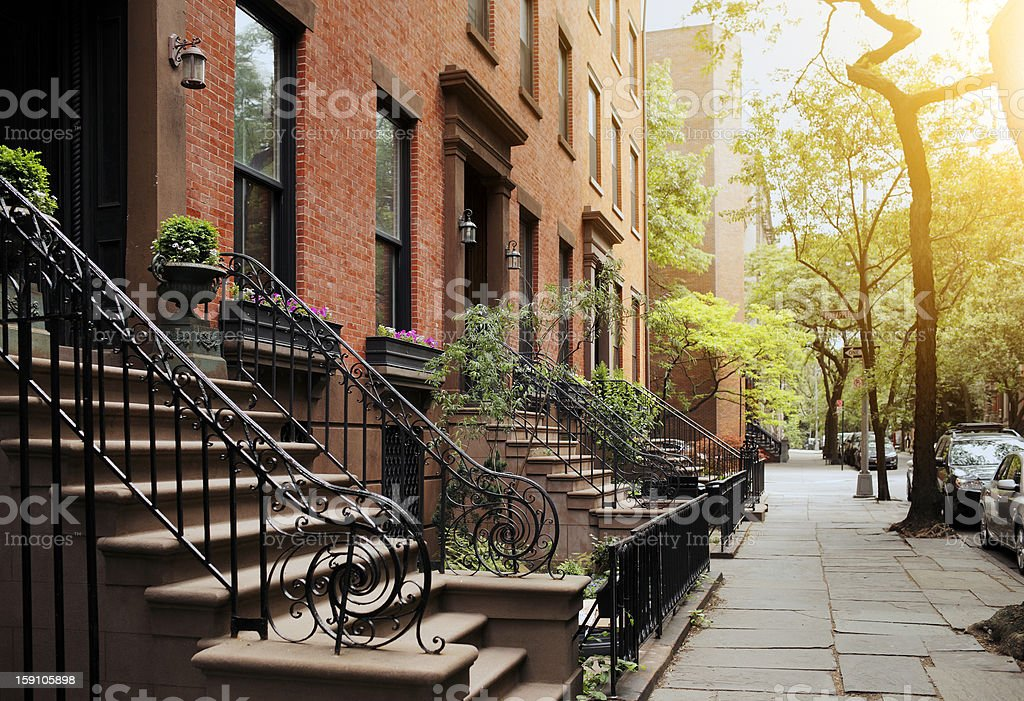 Brownstone and sidewalk in Brooklyn Heights, NY stock photo
