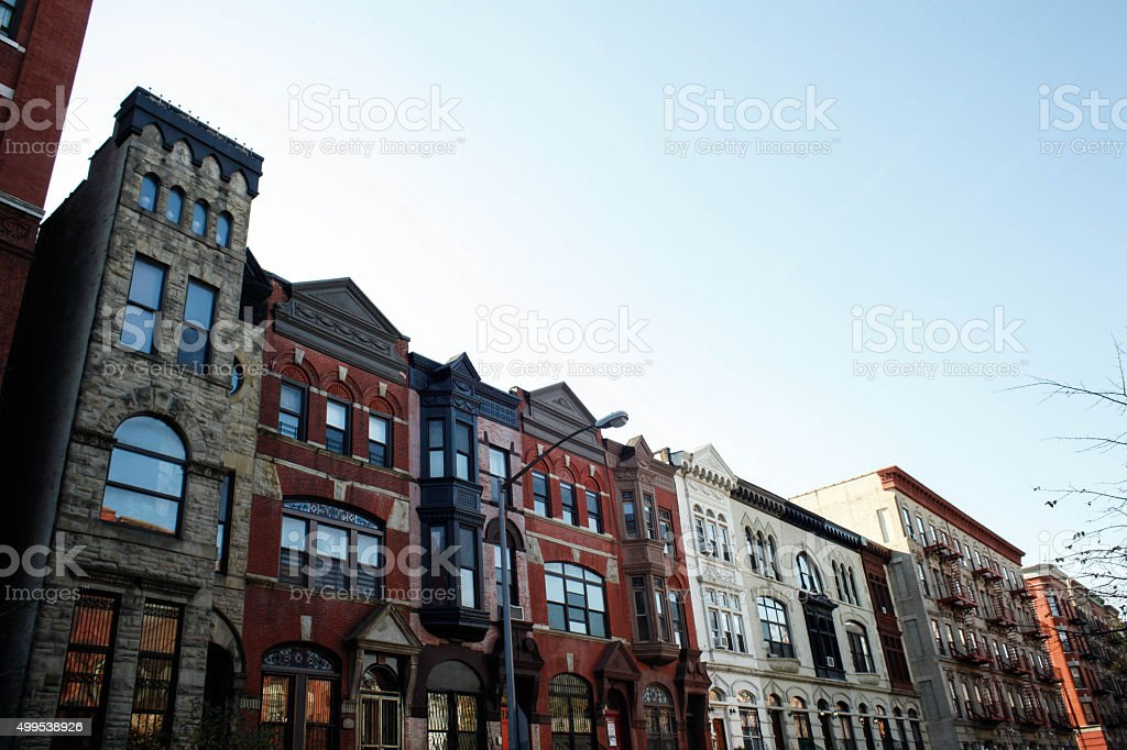 Brownstones and townhouses in urban setting. stock photo